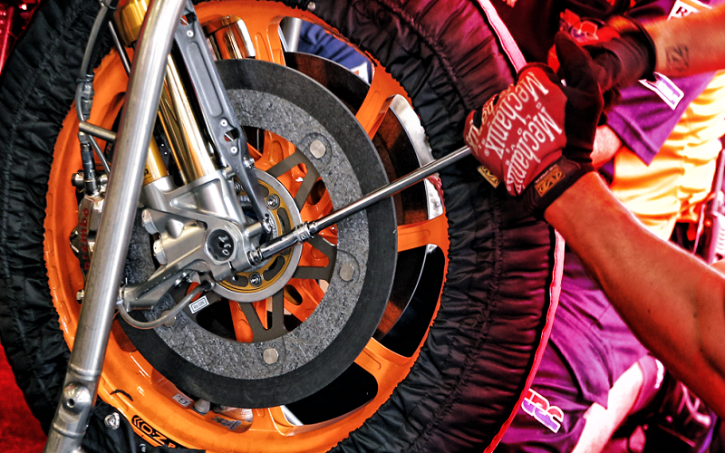 When should we change the brake pads of the motorcycle?